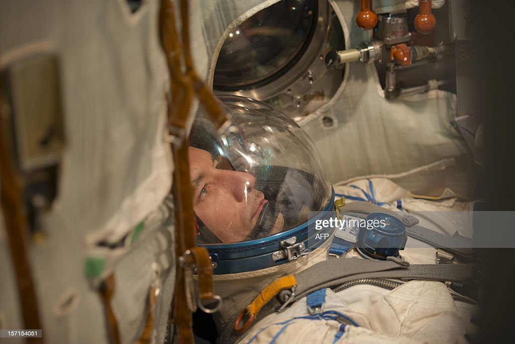 This handout photo released by the European Space Agency (ESA) on November 29, 2012 shows European Space Agency (ESA) astronaut Luca Parmitano training at the Gagarin Cosmonaut Training Centre during in Star City, some 350km southwest of Moscow, on November 27, 2012 during a qualification exam of training. Luca Parmitano is part of the Soyuz TMA-07M back-up crew, with NASA astronaut Karen Nyberg and cosmonaut Fyodor Yurchikhin. The prime crew will be launched in December 2012 to the International Space Station. Parmitano is assigned engineer on a long duration mission to the International Space Station planned for 2013. AFP PHOTO / ESA / STEPHANE CORVAJA