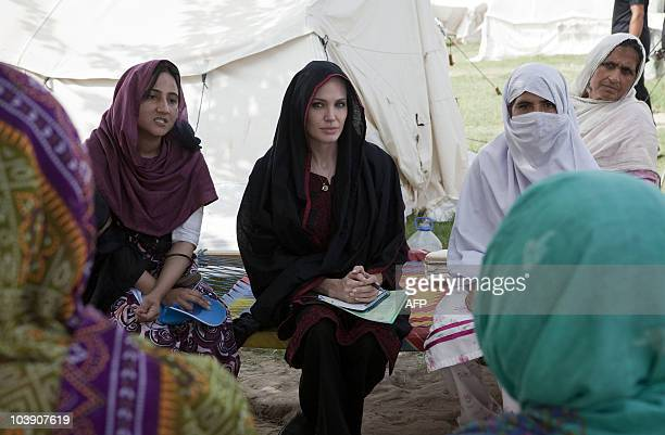 This handout photo released by the UN High Commission for Refugees shows US actress and UNHCR Goodwill Ambassador Angelina Jolie talking with flood...