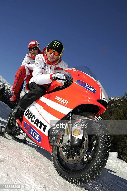 This handout photo released on January 12 2012 by the Vroom 2012 photo service shows Italian Ducati MotoGP rider Valentino Rossi and his teammate US...