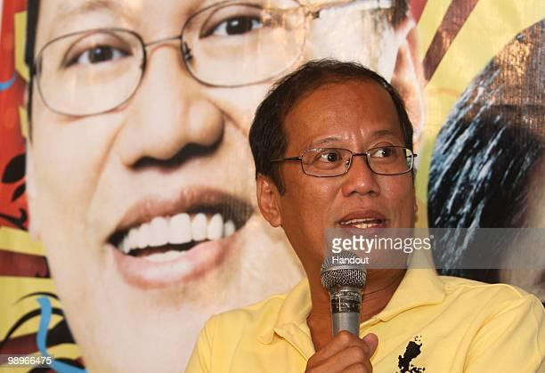 This handout photo shows Philippine Senator Benigno Aquino III as he gestures during a press briefing in Hacienda Luisita on May 11 2010 in Tarlac...