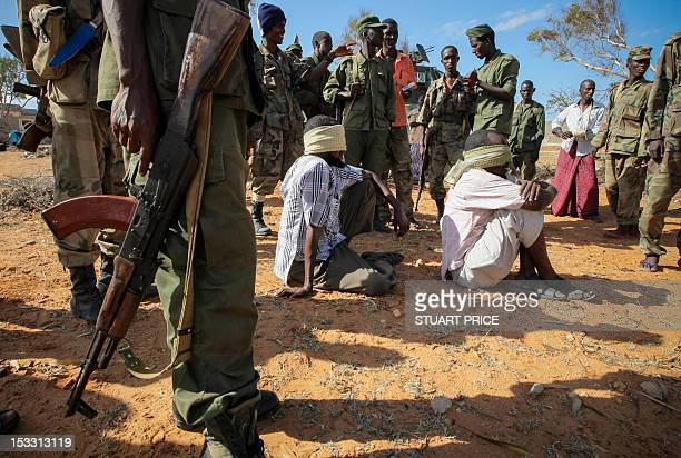 This handout photograph released by the African UnionUnited Nations Information Support Team on October 3 2012 shows alleged suspects of the AlQaeda...