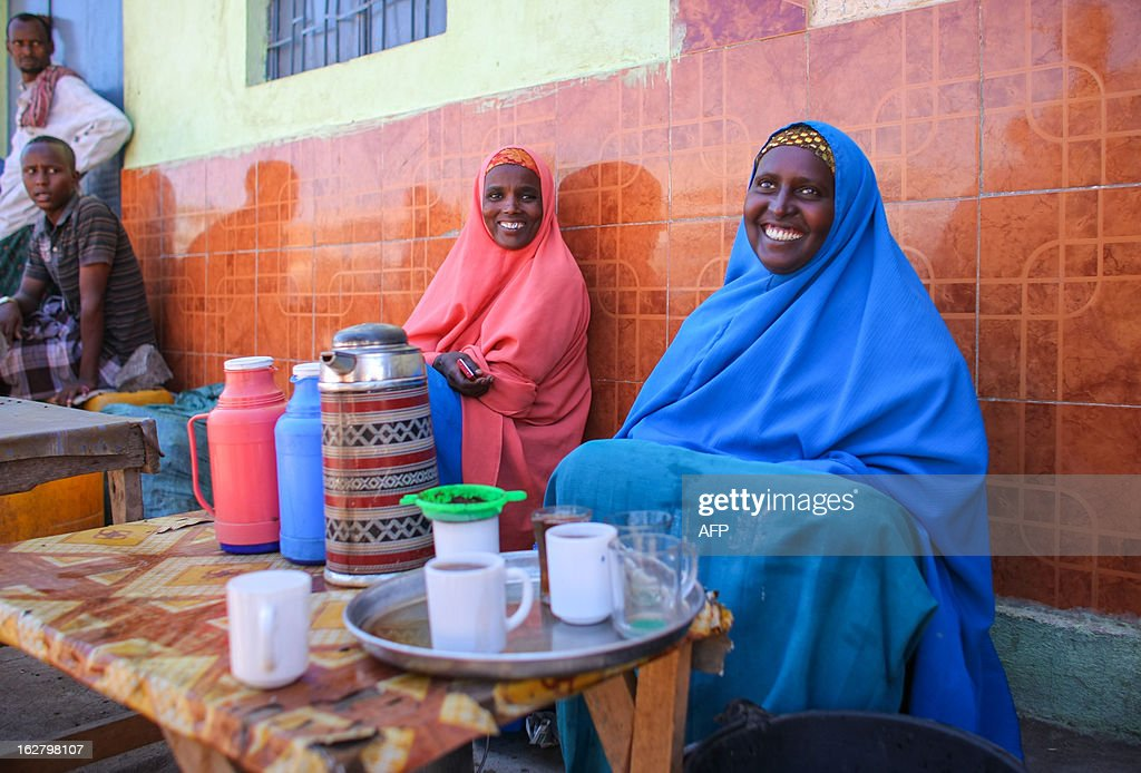 This handout photograph taken and released by the African Union-United Nations Information Support team on February 27, 2012 shows a women selling tea in the central Somali town of Buur-Hakba. The strategically important town on the Afgooye-Baidoa, corridor in Bay region, was liberated from Al-Qaeda-affiliated extremist group Al Shabaab early this morning without any resistance, marking a significant loss for the group. The town, located 64kms east of Baidoa, was a stronghold of the Shabaab where they extorted high levies of illegal taxation on the local civilian populations and used it as a base from where they planned and launched attacks against government forces and installations, AMISOM and the Somali population. Buur-Hakba is the latest in a string of significant territorial losses for the extremist group to SNA and AMISOM forces over the last 18 months, which has seen their area of influence and control over towns and areas across Somalia steadily decrease. AFP PHOTO / AU-UN IST / STUART PRICE CREDIT 'AFP PHOTO / AU-UN IST PHOTO / STUART PRICE' - NO