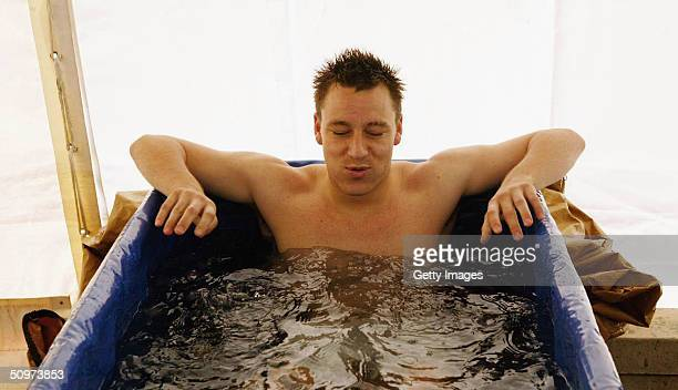 This handout picture from the Football Association shows defender John Terry of England sitting in an ice bath to assist recovery from an injury at...