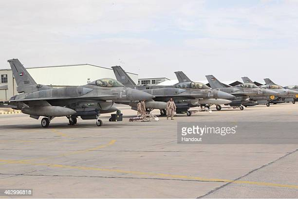 This handout picture released by the official Jordanian news agency PETRA on February 8 shows a squadron of United Arab Emirates F16 fighters...