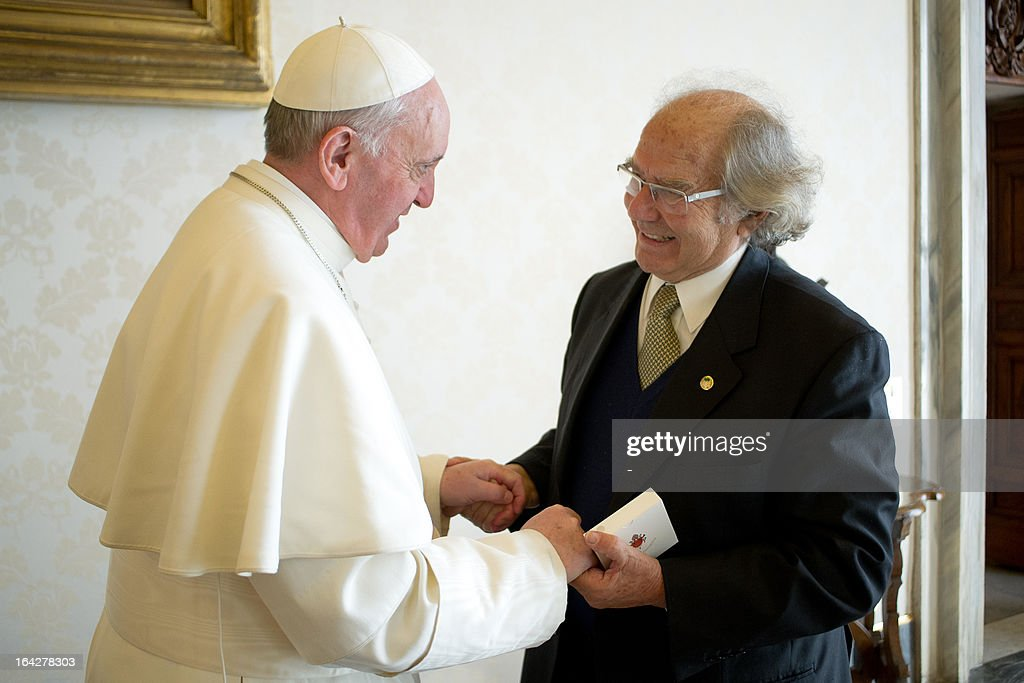 This handout picture released by the Press office shows Pope Francis shaking hands with Argentinian Nobel Peace Prize laureate Adolfo Perez Esquivel on March 21, 2013 at the Vatican in Rome.