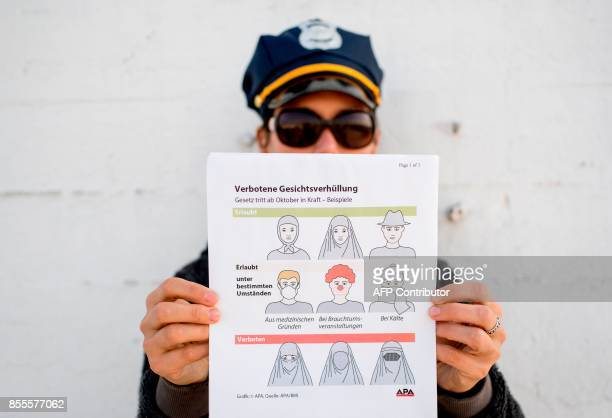 This illustration photo shows a model holding up an information pamphlet about new Austrian restrictions banning the wearing of burqas and other...