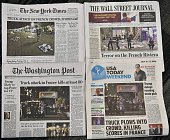 This illustration photo shows the headlines of major US newpapers in Washington DC on July 15 one day after a man plowed a truck into a crowd of...
