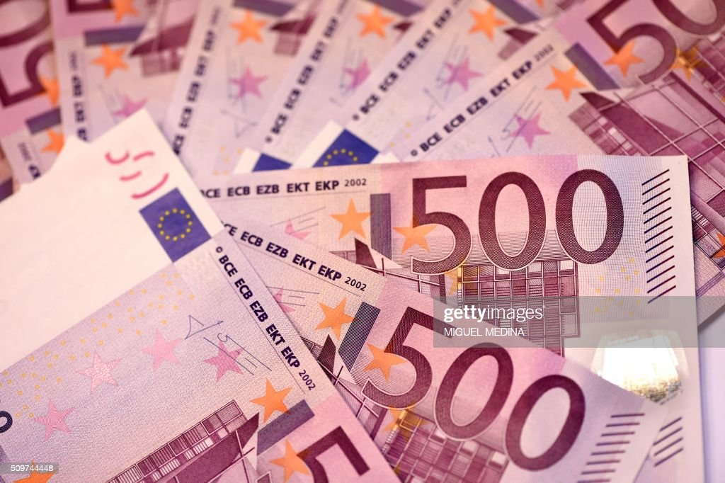 This illustration picture taken on February 12, 2016 in Paris shows several 500 Euro notes displayed in an arrangement. The European Central Bank will take a decision soon on whether to keep printing 500-euro banknotes, with the arguments for doing so becoming 'less and less convincing', a top-ranking official said on February 11, 2016. / AFP / MIGUEL MEDINA