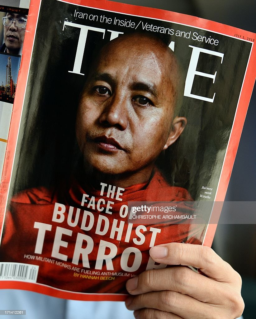 This illustration picture taken on June 24, 2013 in Bangkok shows a man reading a copy of the July 1 issue of Time magazine carrying a picture of controversial Myanmar monk Wirathu on its cover. Myanmar has reacted angrily to a Time magazine cover story on a prominent radical monk accused of fuelling anti-Muslim violence, accompanied by the headline 'The Face of Buddhist Terror'. The Time report 'creates a misunderstanding of Buddhism which has existed for thousands of years and is the religion of the majority of our citizens,' said a statement posted on the presidential office website late on June 23. AFP PHOTO/Christophe ARCHAMBAULT