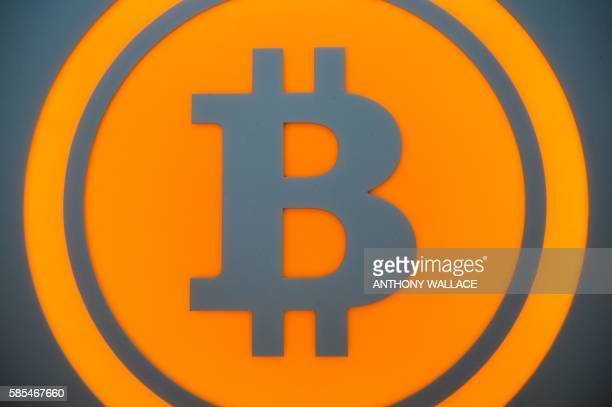 This illustration shows a Bitcoin sign in Hong Kong on August 3 2016 A major Hong Kongbased Bitcoin exchange has suspended trading after 65 million...