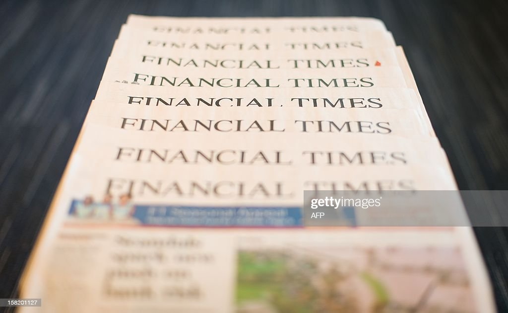 This illustrative picture taken in London, England on December 11, 2012 shows copies of the Financial Times newspaper. British publisher Pearson said on December 11, 2012 that its flagship business newspaper The Financial Times was not for sale, in response to recent media speculation. AFP PHOTO/Leon Neal