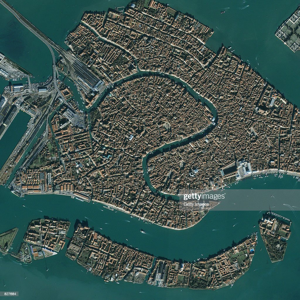 This image captured by a satellite on November 27, 2000 shows the city of Venice, Italy. Venice has more than 400 bridges that span 114 canals. Points of interest in the image are the Railway Station, the Grand Canal and St. Mark's Square. Across the canal from St. Mark's Square is San Giorgio Maggiore, a church and monastery founded in the 10th century.