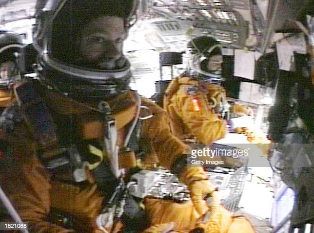This image from NASA video shows Mission Specialists Laurel Clark Shuttle Pilot William McCool and Commander Rick Husband on the flight deck of the...