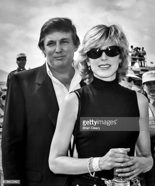 This image has been converted to back and white Donald Trump L walks in the pits with Marla Maples before before the Indy 200 Indy Racing League IRL...