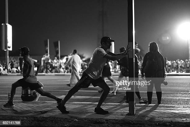 This image has been processed using digital filters Runners are shown prior to the Standard Chartered Dubai Marathon 2017 on January 20 2017 in Dubai...