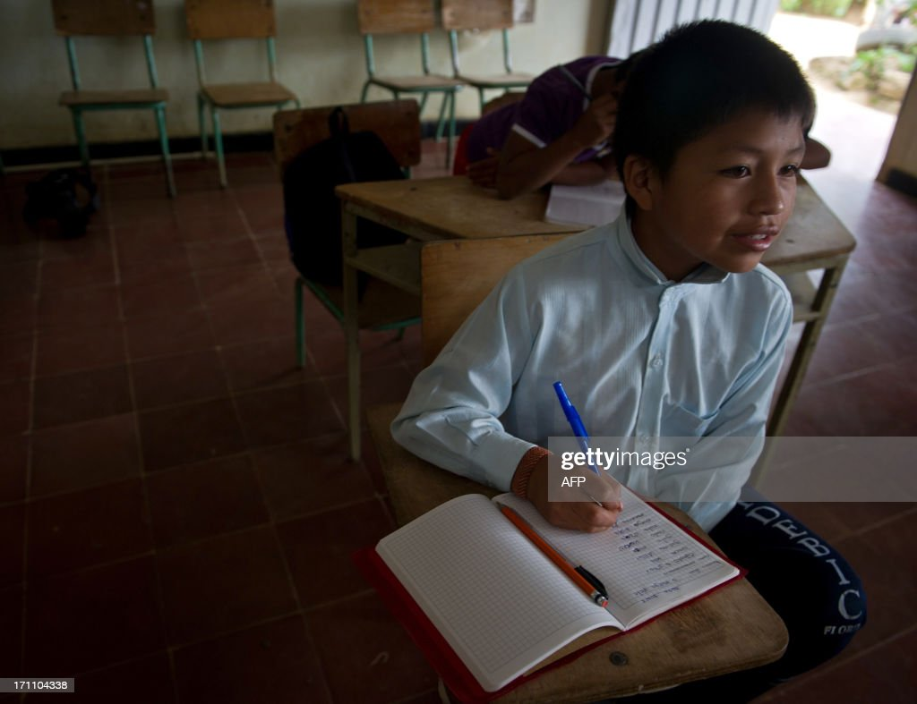 This image is part of a photo package on children going to school around the world Colombian indigenous child from the Nasa ethnic group Gari Camayo...