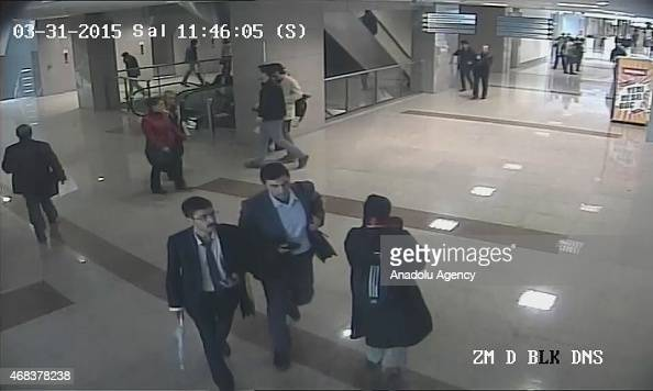 This image obtained from Istanbul courthouse surveillance camera footage on March 31 2015 shows 2 terrorist gunmen walking towards Turkish prosecutor...