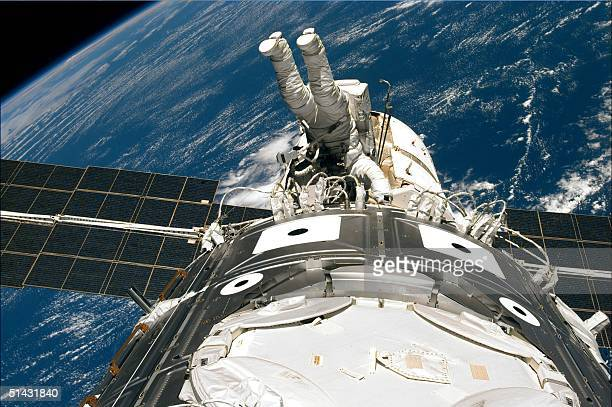 This image released 13 December by NASA shows US space shuttle Endeavour crew member Jim Newman of the US wraps up work 12 December on the outside of...