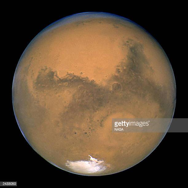 This image released August 27 2003 captured by NASA's Hubble Space Telescope shows a closeup of the red planet Mars when it was just 34840 miles away...