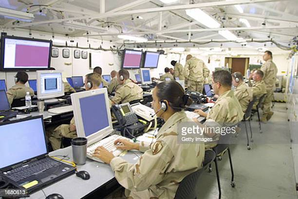 This image showing soldiers monitoring computer screens inside the US Central Command's 'Deployable Headquarters' was released by the US military...
