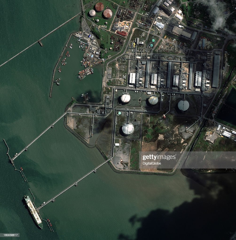 This image shows Atlantic LNG Company's four-train liquefaction plant in Point Fortin on the southwestern coast of Trinidad. Natural gas from the country's field sites is brought into the plant through pipelines. It is then processed and liquefied in facilities known as trains before being exported in specialized tankers where it's maintained at a temperature of -162 degrees Celsius. The four trains have the capacity to produce up to 100,000 cubic meters of LNG per day.