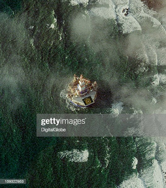 This image shows Shell Global's mobile drilling vessel the Kulluk­ grounded 228 meters off Alaska's Sitkalidak Island. Sitkalidak Island is located 490 kilometers south of Anchorage and just southeast of Kodiak Island. The Kulluk had been used for exploratory drilling in the Beaufort Sea earlier this year. On December 31, 2012, the vessel was being towed to Seattle by the Aiviq when the tow line snapped in rough seas with hurricane-force winds.