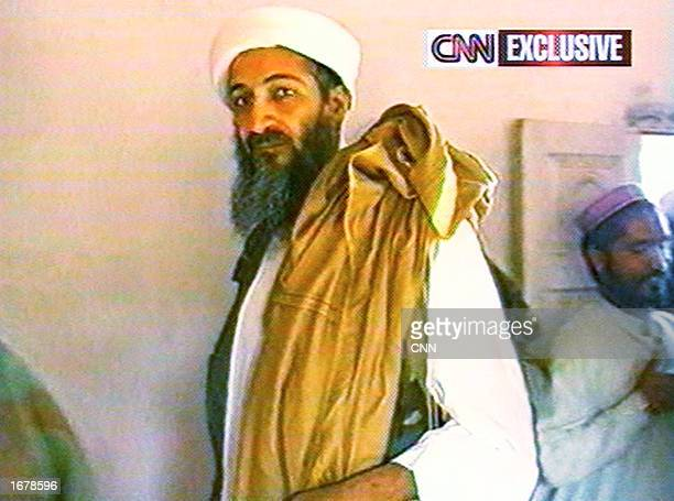 This image taken from a collection of videotapes obtained by CNN shows Saudi terrorist suspect Osama bin Laden arriving at a press conference on May...