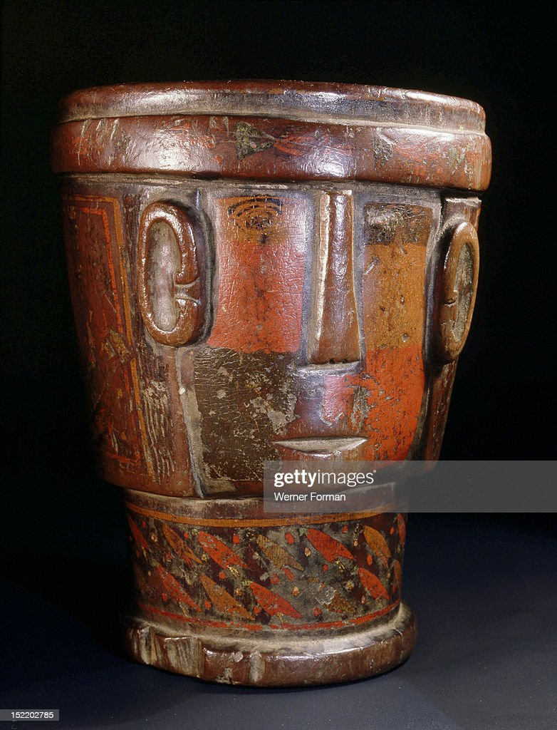 This Inca kero a wooden goblet was used by people of high status during religious rituals This example is an effigy representing a stylized big ear...