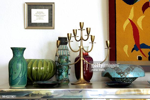 This is a grouping of mid–century collectibles in the living room For INTERIOR MONOLOGUE The focus is on how the owners of a 60's Palm Springs tract...