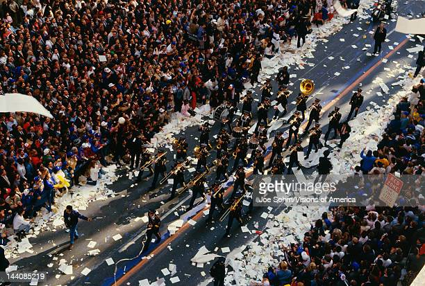 This is a marching band in a Ticker Tape Parade on Broadway and Wall Street It took place in the Canyon of Heroes There were about 22 million people...