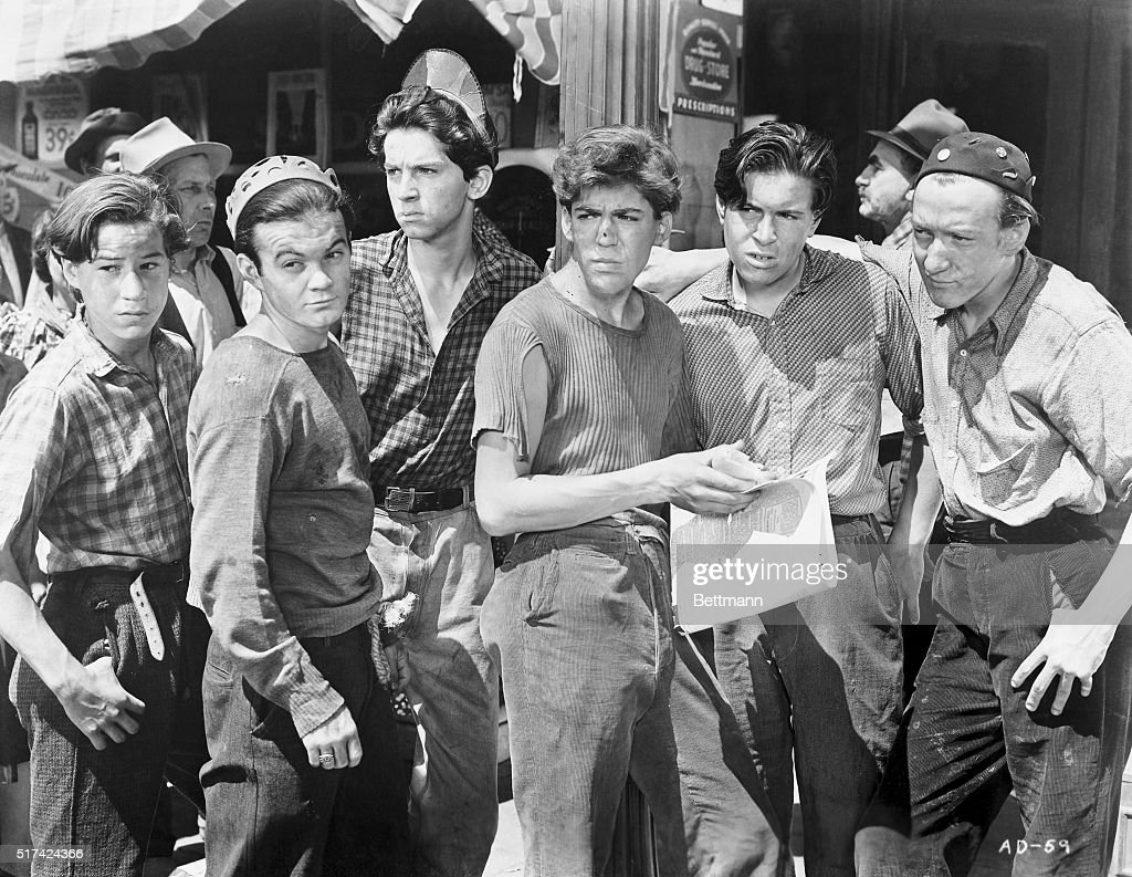 This is a photograph of the Dead End Kids characters on the set. They are Bobby Jordan, Leo Gorcey, Gabriel Dell, Billy Halop, Bernard Punsly, and Huntz Hall.