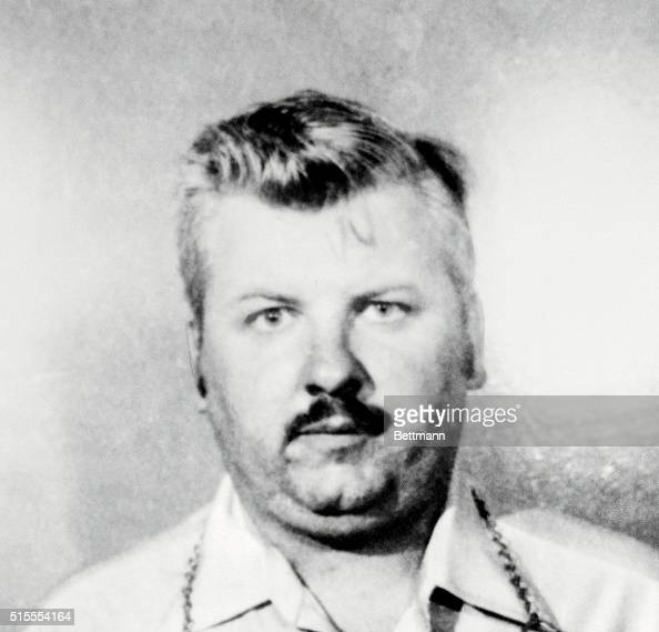This is a police photo of John Wayne Gacy being held for questioning in connection with the discovery late 12/21 of five badly decomposed bodies The...