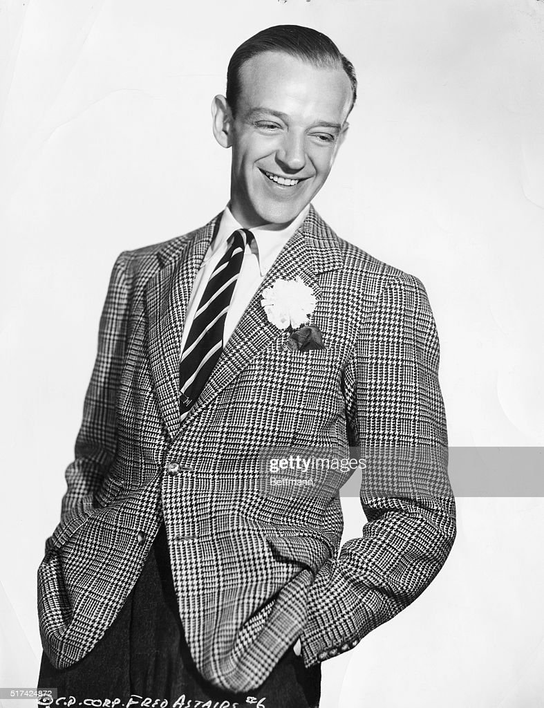 This is a portrait of actor and dancer <a gi-track='captionPersonalityLinkClicked' href=/galleries/search?phrase=Fred+Astaire&family=editorial&specificpeople=70031 ng-click='$event.stopPropagation()'>Fred Astaire</a>, looking to the side and smiling.