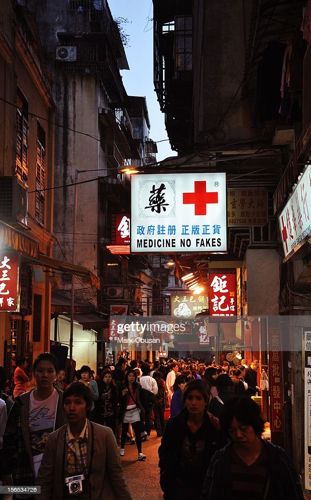 This is a real sign of a pharmacy / drugstore in Macau SAR, China. Chinese goods are often passed off as originals but later on turn out to be copies.