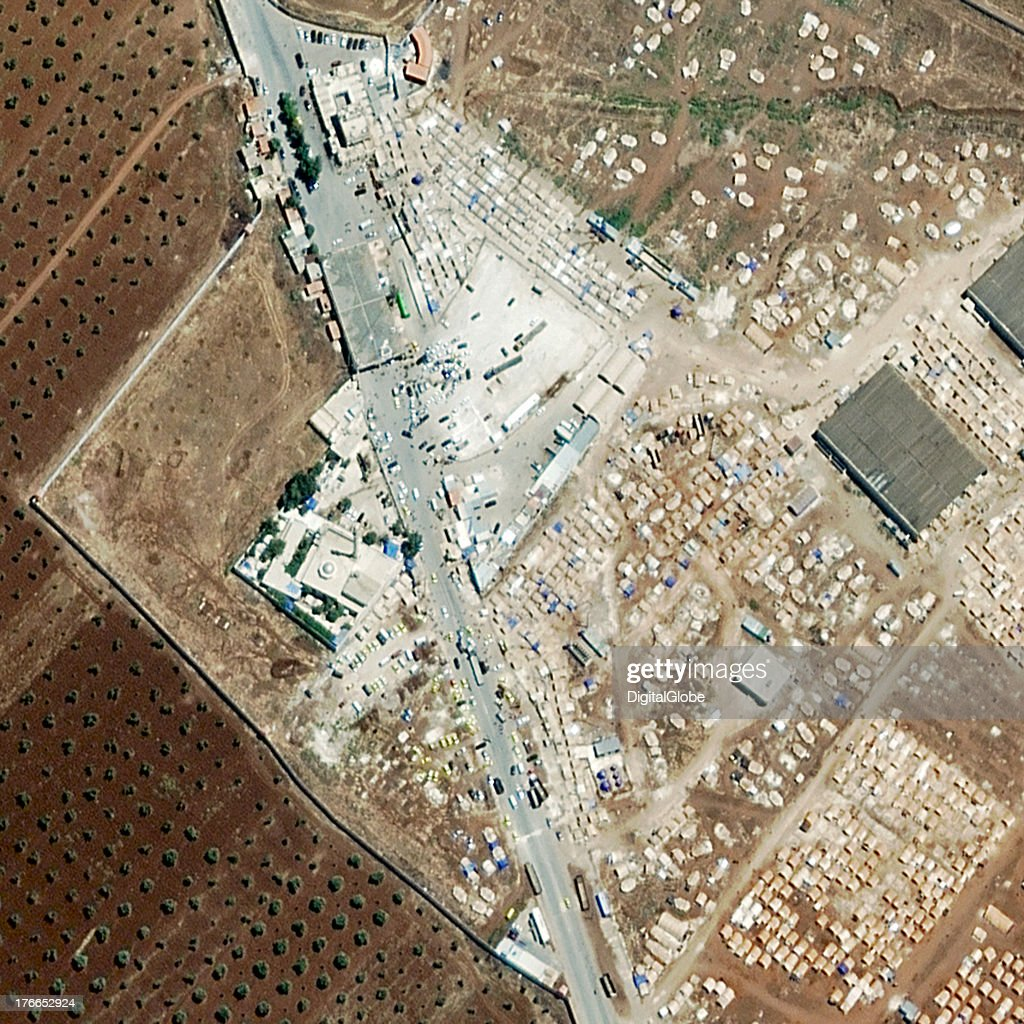REFUGEES, SALEMEH, SYRIA - AUGUST 16, 2013: This is a satellite image of a border crossing in Syria were refugees are trying to leave the country.