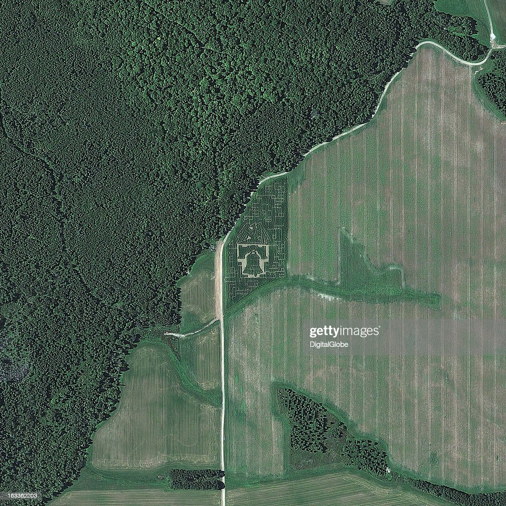 This is a satellite image of a corn maze displaying the Freedom Eagle and Liberty Bell in Caribou, Maine, United States. Collected on September 11, 2012.