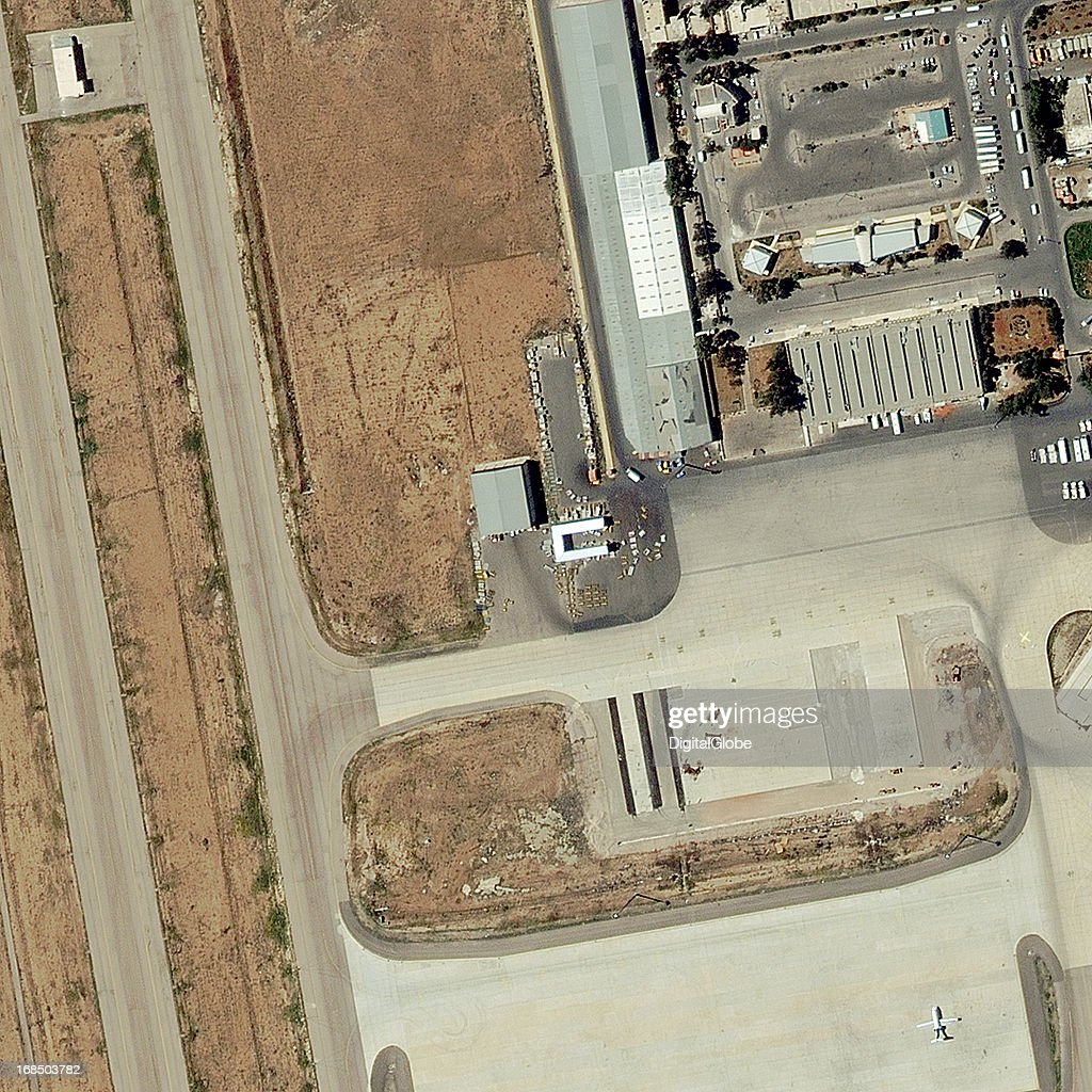 This is a satellite image of a warehouse and storage buildings at Damascus International Airport that stored a large quantity of missiles according to reports. This area was targeted by a military airstrike on May 4, 2013.