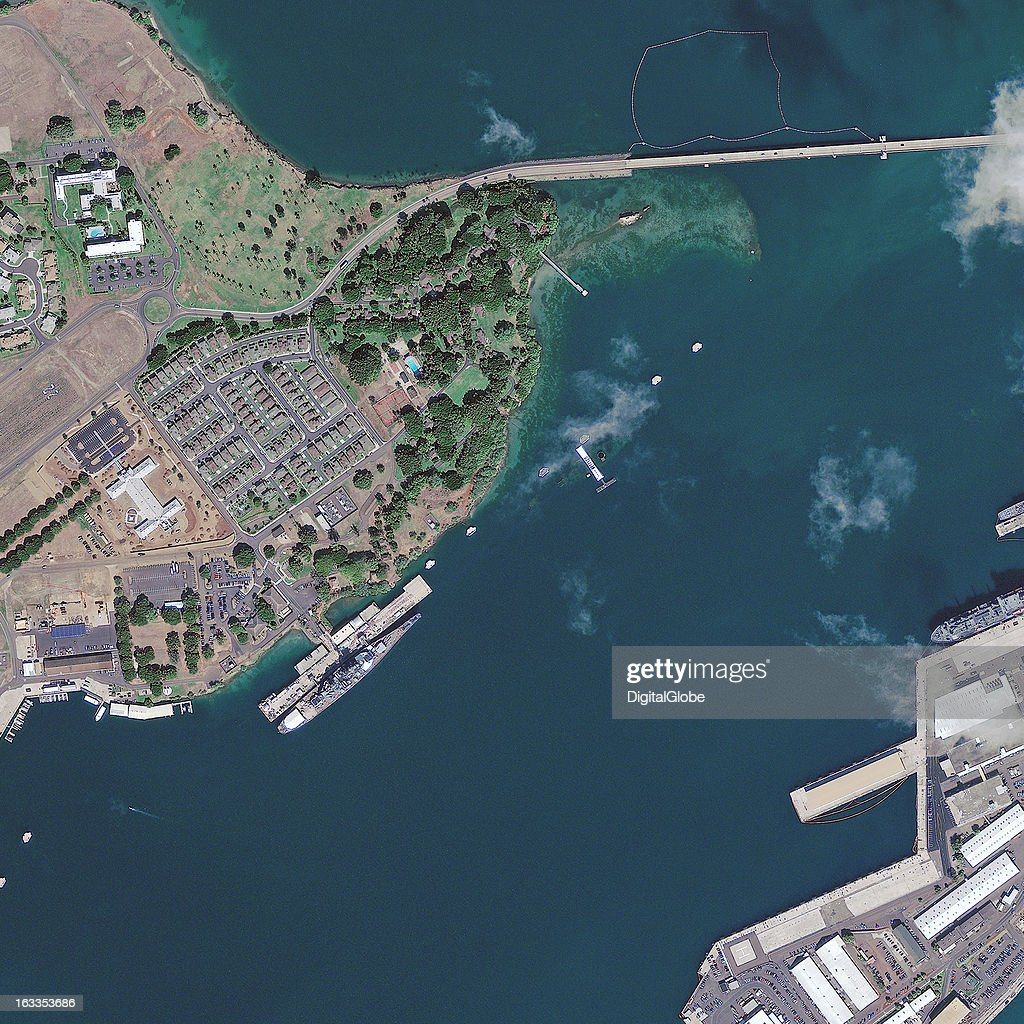 This is a satellite image of Pearl Harbor in Oahu, Hawaii, United States, showing the eastern edge of Ford Island with the Battleship Missouri Memorial and the USS Arizona Memorial. Collected on December 1, 2011.