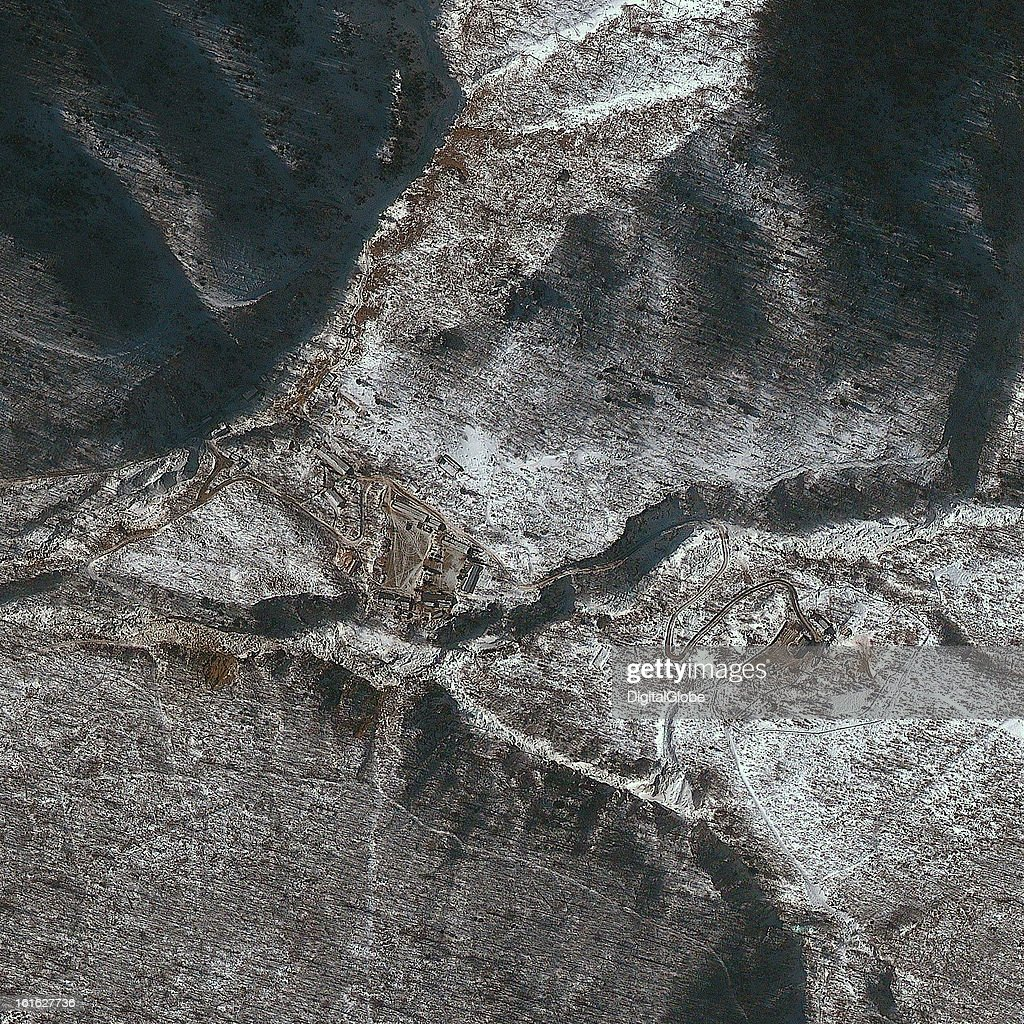 This is a satellite image of Punggye-ni Nuclear Test Facility in North Korea collected on February 9, 2013. Vehicle tracks are visible in the main parking area.