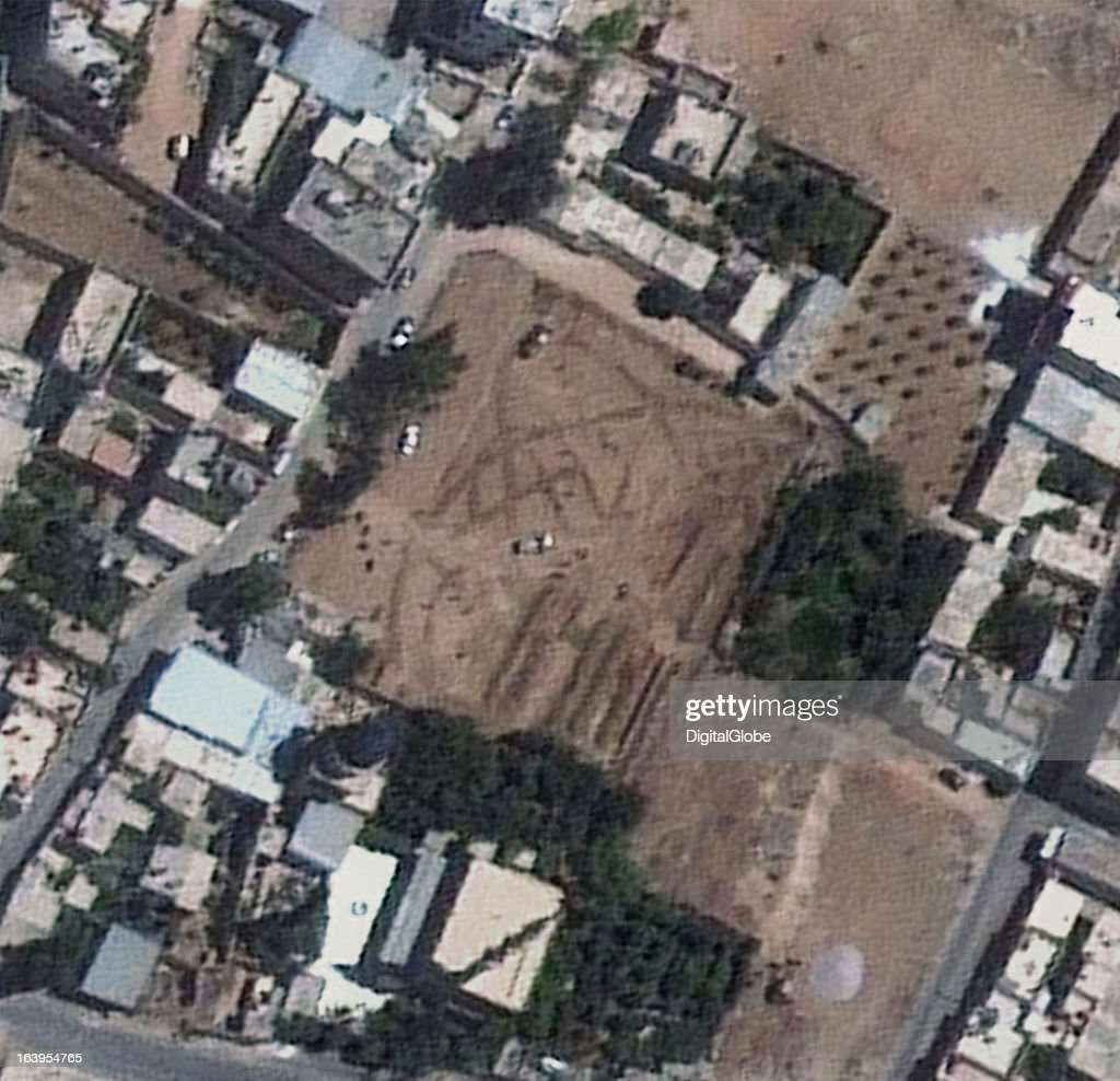MOSQUE, DAMASCUS, SYRIA - AUGUST 28, 2012: This is a satellite image of the Daryya Mosque, Damascus, Syria, showing the digging operation and filling of mass graves, collected on August 28, 2012.
