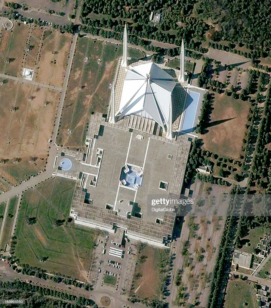This is a satellite image of the Faisal Mosque, considered the National Mosque of Pakistan, and sits on the edge of Islamabad in the Margalla Hills. Designed by Turkish architect Vedat Dalokay, it is the largest mosque in Pakistan and the sixth largest in the world.