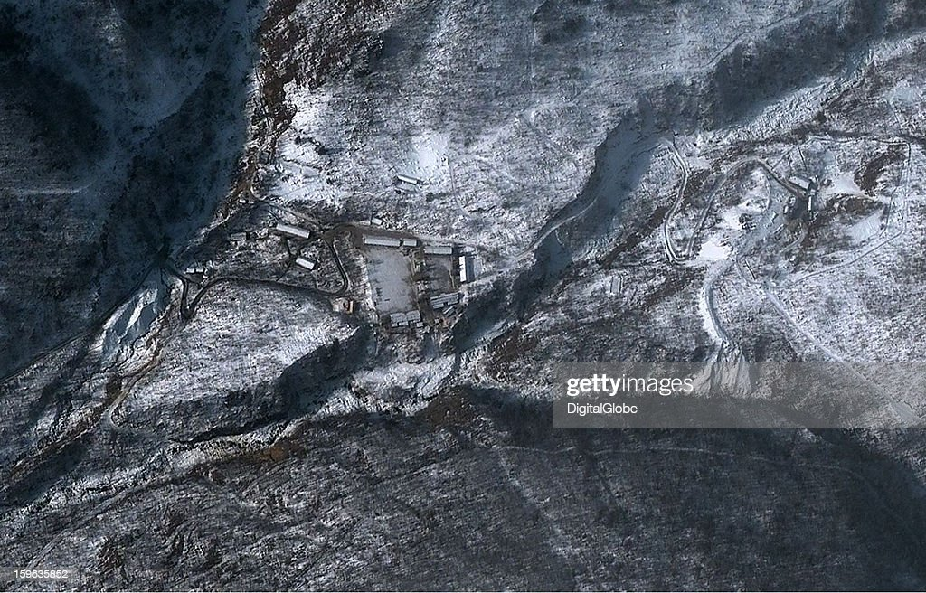 This is a satellite image of the Punggye-ni Nuclear Test Facility in North Korea collected on December 2, 2012. There is evidence of recent flooding, as half of the spoil pile from the newest excavated tunnel has been washed away, along with mine ore cars and the associated rail line.