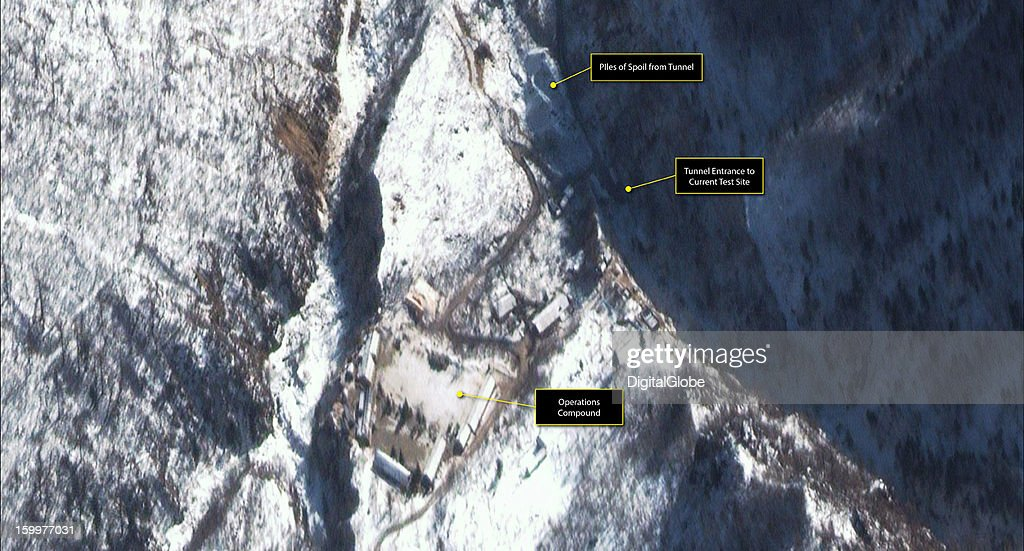 This is a satellite image of the Punggye-ni Nuclear Test Facility in North Korea collected on January 12, 2013. There is evidence of ongoing activity at this facility as the road appears to have been heavily trafficked between the tunnel entrance of the current test site and the operations compound where support vehicles are present.