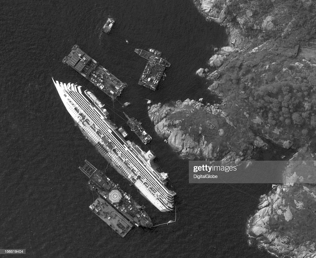 This is a satellite image of the salvage operations of the Costa Concordia along the coastline of Giglio Island in Itlay. This is the largest salvage operation ever, comprised of 450 crew who are working to stabilize the vessel with four massive cables.