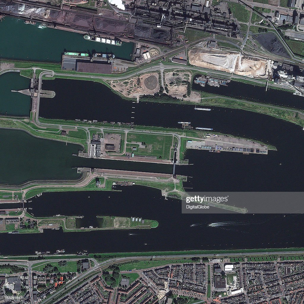 CANALS, IJMUIDEN, NETHERLANDS - SEPTEMBER 9, 2012: This is a satellite image of the shipping canals, known as the gateway to the North Sea in IJmuiden, Netherlands. Collected on September 9, 2012.