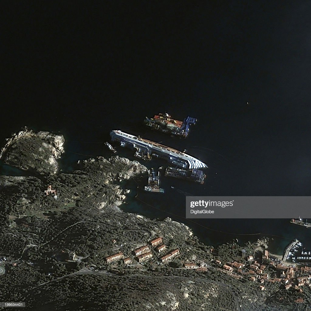 This is a satellite image of The shipwreck cleanup efforts of the Costa Concordia crusie ship in Giglio Porto, Italy, collected on January 4, 2013.