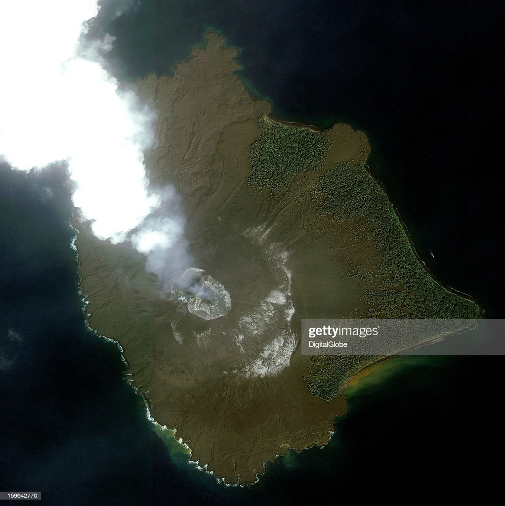 This is a satellite image of the volcanic island of Krakatoa, as ash and smoke billow from its crater.