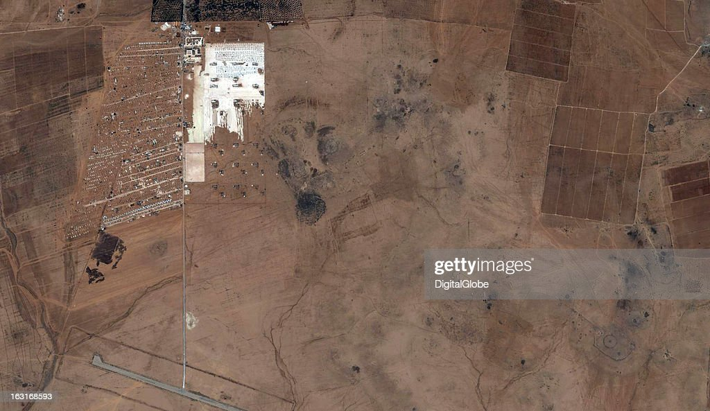 This is a satellite image showing the expansion of the Zaatari Refugee Camp in Jordan, just across the border from Syria.