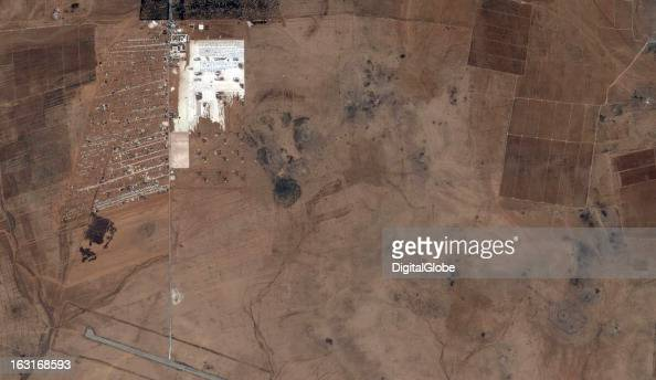 This is a satellite image showing the expansion of the Zaatari Refugee Camp in Jordan just across the border from Syria