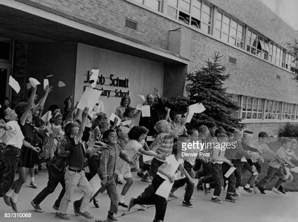 This Is A Warmup For The Real Thing But Children At Schmitt Elementary School Enjoy It Waving 'goodby' is Principal Melvin G Rodie and teacher Miss...